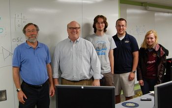 Photo of researchers on the Visual Cortex on Silicon team with three students.
